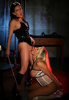 Sexy blonde in lingerie dominated by strict mistress